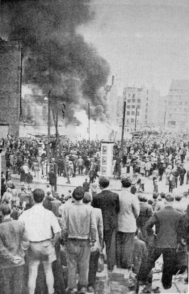"""Berlin, June 17, 1953—The people watch the """"people's"""" police station burn."""