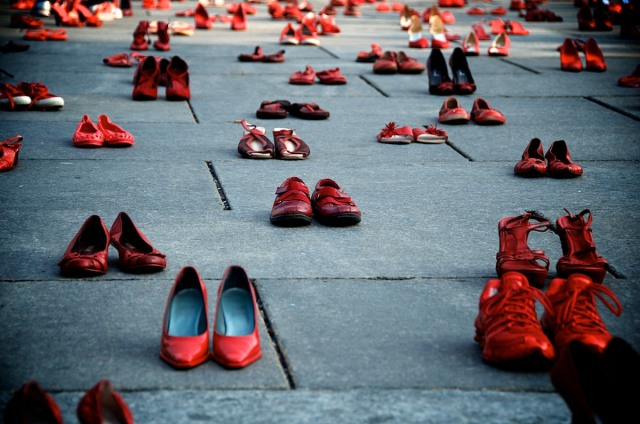"One of Elina Chauvet's installations titled ""Zapatos Rojos,"" at Castle Square, Turin, Italy. Each pair of red shoes represents a woman brutally murdered in Mexico whose killer has never been brought to justice. Photo by Franco Baldan, http://www.naturadigit.com/2013/03/scusa.html"